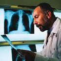 man reading x-ray charts